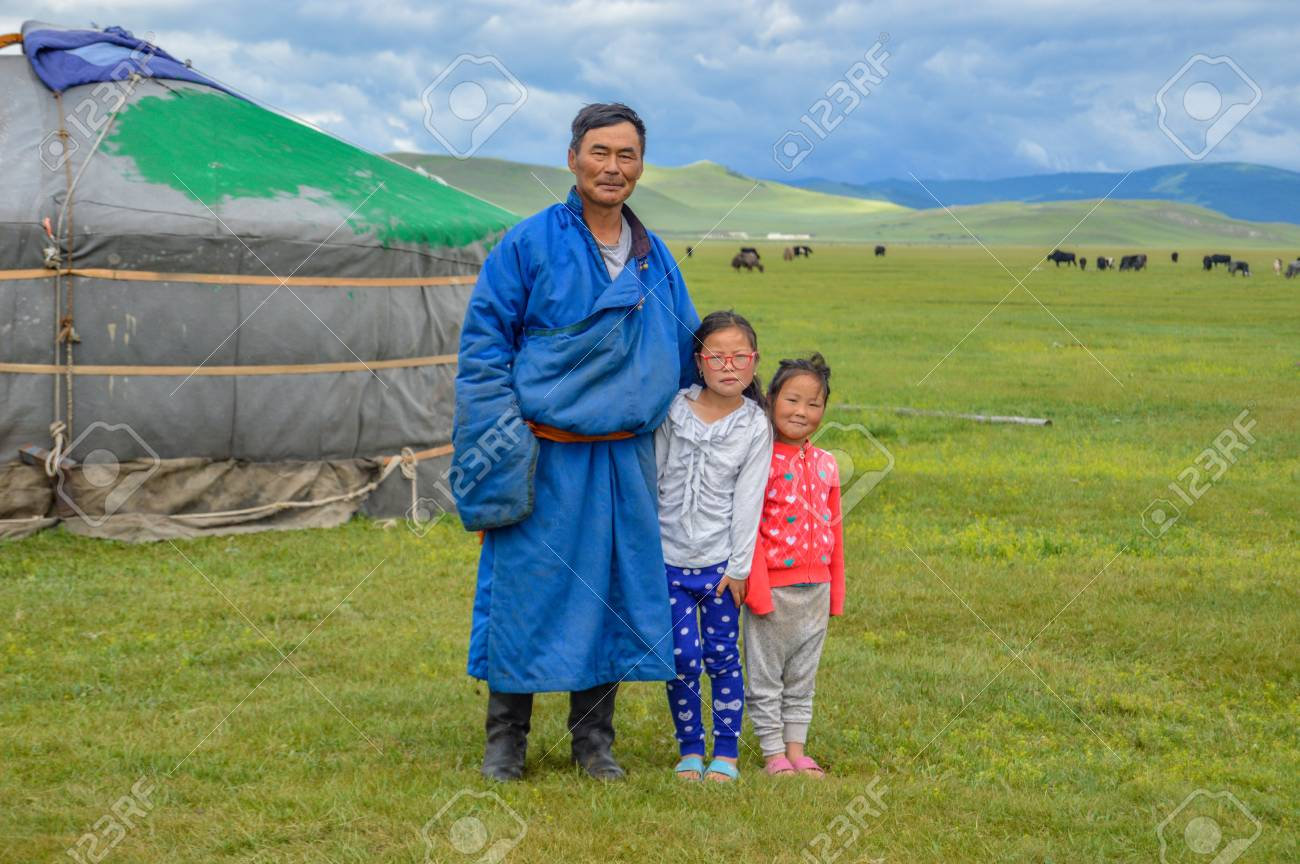 128407350-mongolian-nomad-with-his-two-daughters-standing-near-his-ger-or-yurt-with-his-animal...jpg