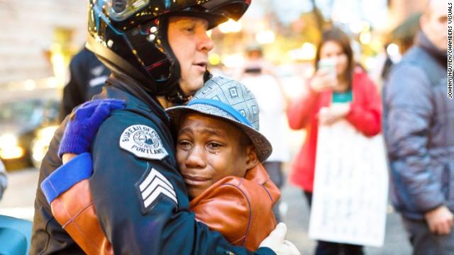 141129122705-portland-ferguson-protest-hug-story-top[1].jpeg