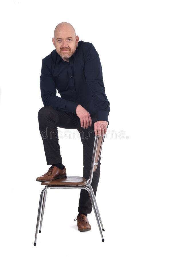 man-standing-chair-white-background-foot-over-chair-man-standing-chair-white-background-foot-o...jpg