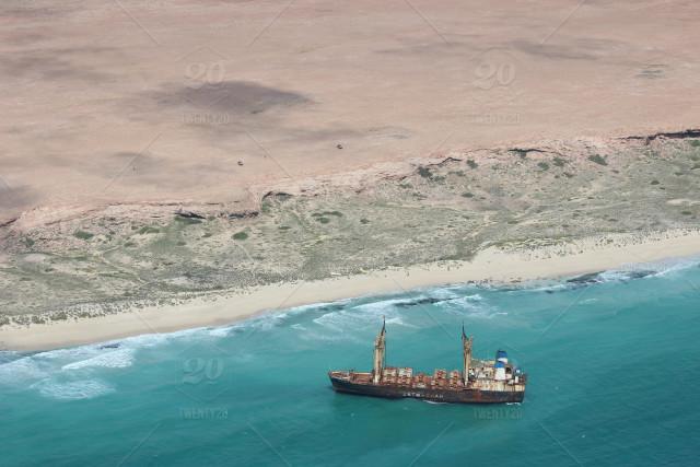 stock-photo-boat-beach-landscape-ship-africa-ocean-shore-pirates-hostages-da778a63-8d6c-4ded-9...jpg