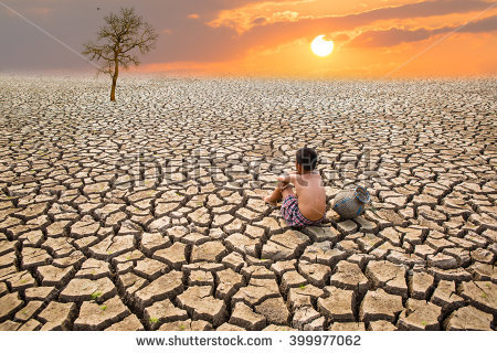 stock-photo-child-sit-on-cracked-earth-in-the-arid-area-399977062.jpg
