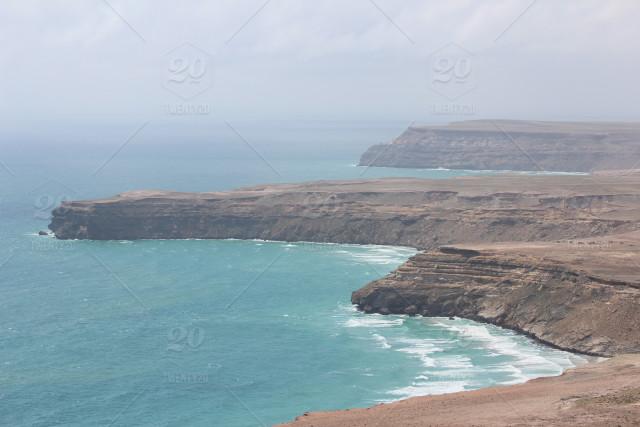 stock-photo-coastline-beach-landscape-africa-ocean-shoreline-amazing-cliffs-422056ad-b5de-4966...jpg